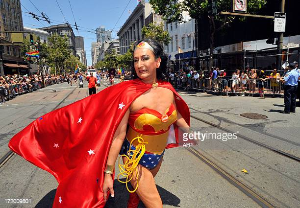 A gayrights supporter who goes by the name Garza prances along the parade route dressed as Wonder Woman at San Francisco's Gay Pride festival in...
