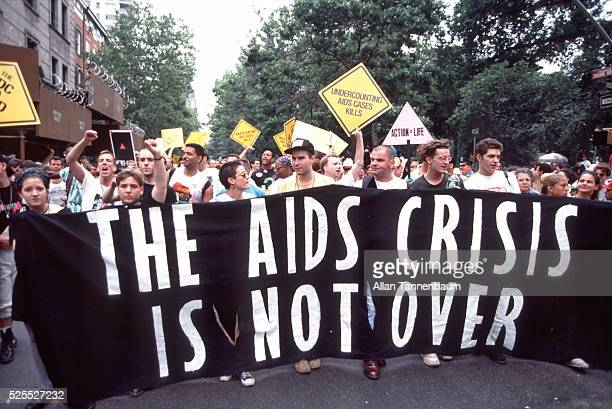 Gays and Lesbians carry banner about the AIDS epidemic in the Gay Pride Parade on Central Park South New York New York June 30 1991