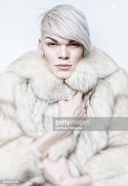 Gay/Trans man in fur coat