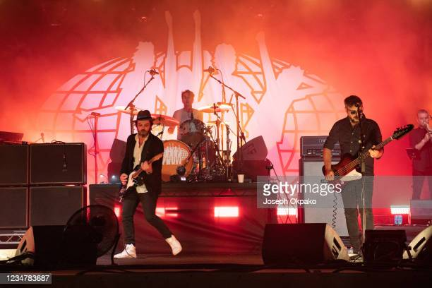 Gaz Coombes, Danny Goffey and Mick Quinn of Supergrass perform at South Facing Festival on August 20, 2021 in London, England.