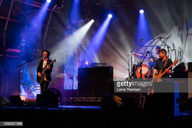 Gaz Coombes Danny Goffey and Mick Quinn of Supergrass perform at South Facing Festival on August 20, 2021 in London, England.