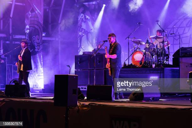 Gaz Coombes. Mick Quinn and Danny Goffey of Supergrass perform at South Facing Festival on August 20, 2021 in London, England.