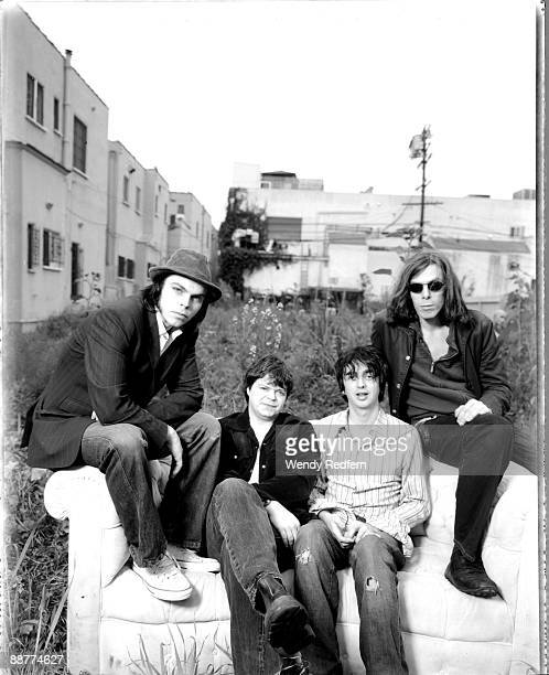 Gaz Coombes, Mick Quinn, Danny Goffey and Rob Coombes of Supergrass pose for a group shot on May 1, 2003 in Los Angeles, California.