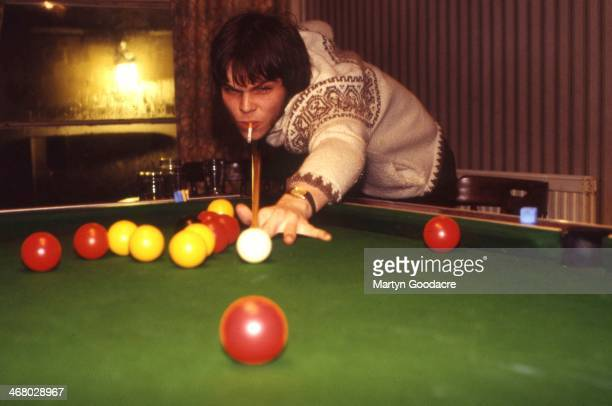 Gaz Coombes of Supergrass, playing pool, Oxford, United Kingdom, 1994.