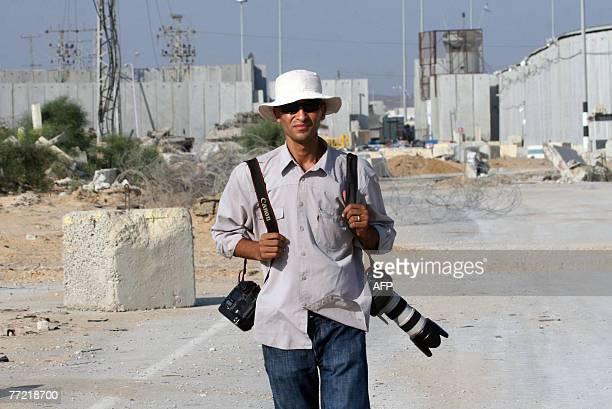 Gaza Stripbased AFP photographer Mahmud Hams looks on as the Erez crossing between Israel and northern Gaza Strip appears behind him 31 July 2007...