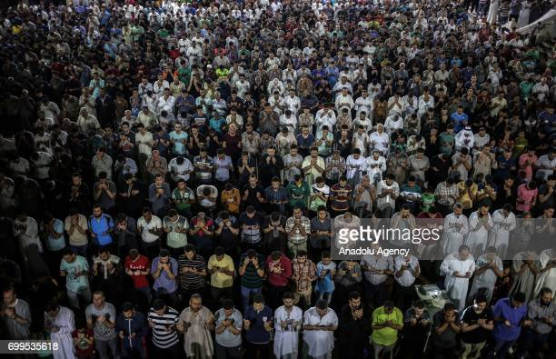 Gazaian Muslims pray during a Tarawih Prayer break on Laylat alQadr the night when the first verses of the Quran were revealed at the Great Mosque of...