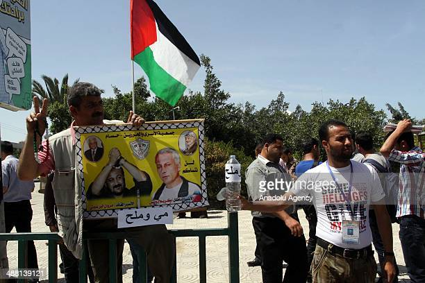 Gazaian people serve saltwater to mark the Palestinian prisoners in Israeli jails who staged hunger strike in Gaza on May 4 2014
