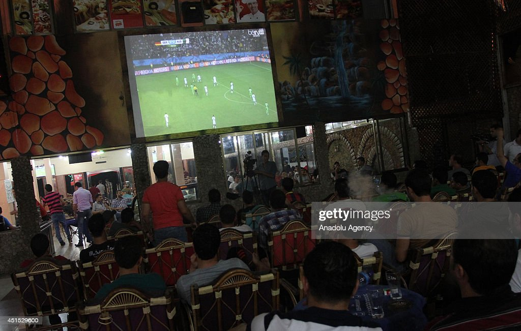 Gazaian soccer fans watch the 2014 FIFA World Cup Brazil Round of 16 match between Germany and Algeria, on the giant screens, in Gaza, June 30,2014.