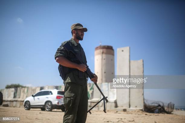 Gazaian soldier stands guard during Palestinian Legislative Council's committee's visit in Gaza City Gaza on August 23 2017 A committee of...