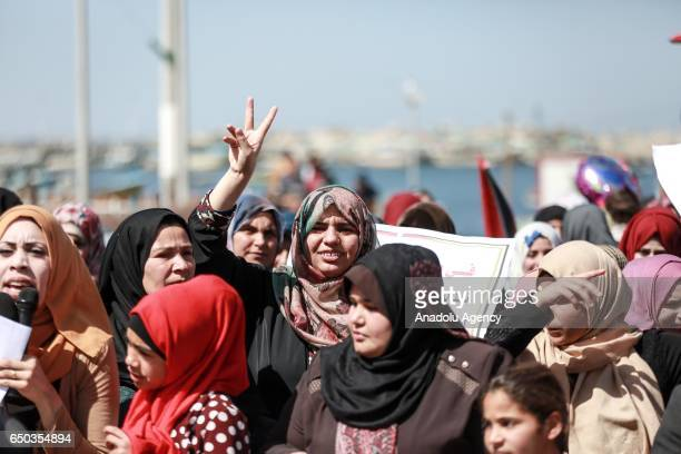 Gazaian woman gestures during a protest marking Israel's violations against Palestinian fishers on the International Women's Day organized by...