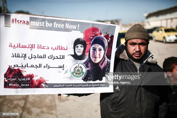 Gazaians carries a placard during a solidarity protest in support of Palestinian Isra Ceabis who was sentenced to 11 years after a kitchen tube in...