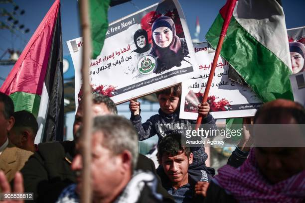 Gazaians carry banners and placards during a solidarity protest in support of Palestinian Isra Ceabis who was sentenced to 11 years after a kitchen...