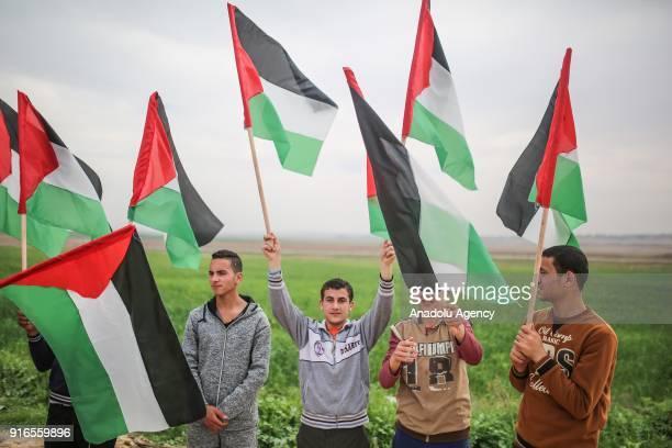 Gazaians hold Palestinian flags during a protest against Israeli blockade on Gaza since 2007 near Jabalia Refugee Camp in Gaza City Gaza on February...