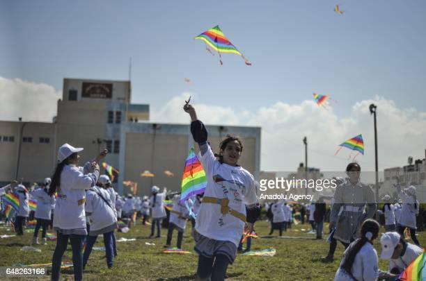 Gazan children fly kites to commemorate the earthquake and the tsunami disasters which hit Japan in 2011 during an event organized by the United...