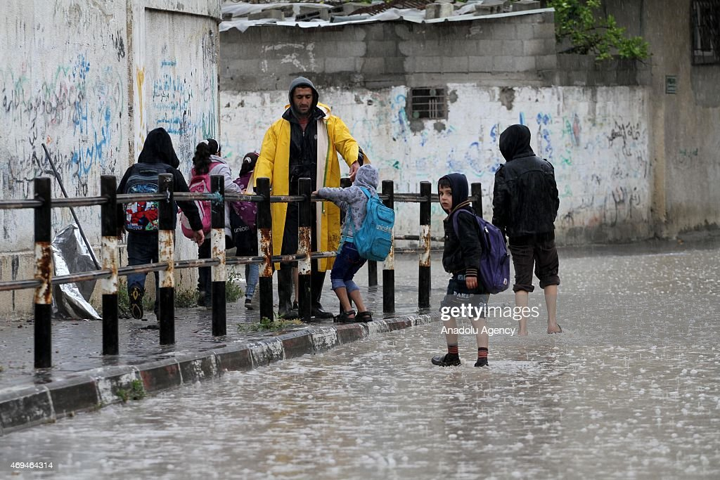 Gazan students are evacuated from the flooded schools as the heavy rain hits Gaza City, Gaza on April 12, 2015. Many areas submerged due to the downpour in Southern and Northen parts of Gaza.