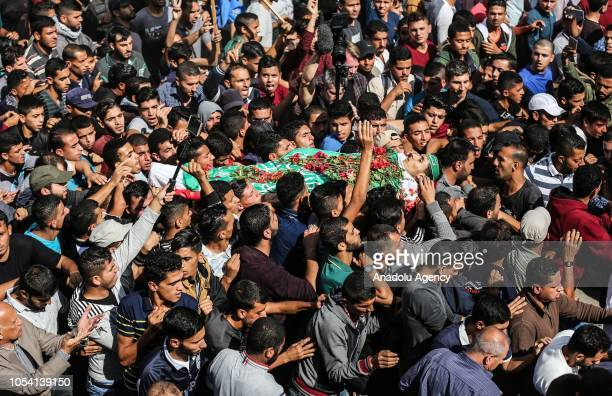 "Gazans carry the dead body of Ahmad Said Abu Lebde , who was killed after Israeli soldiers intervened in ""Great March of Return"" demonstrations,..."