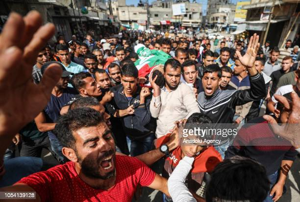 Gazans carry the dead body of Nassar AbuTayem who was killed after Israeli soldiers intervened in Great March of Return demonstrations during his...