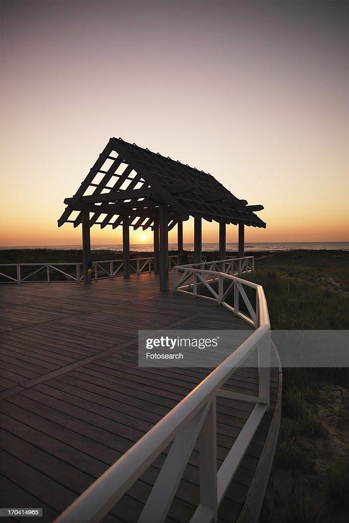 Gazebo at North Carolina coast with setting sun : Stock Photo