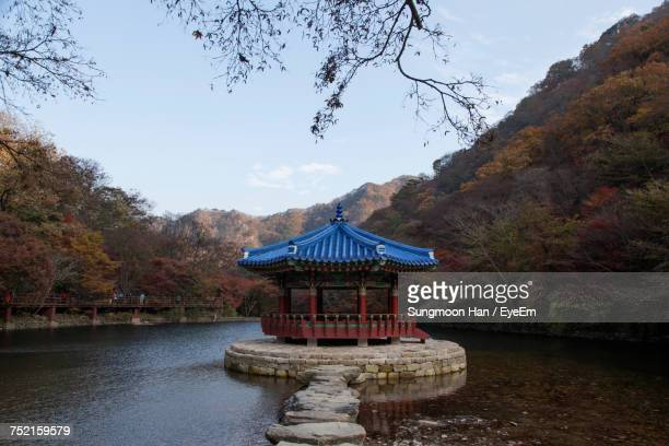 gazebo in lake against sky - jeonju stock pictures, royalty-free photos & images