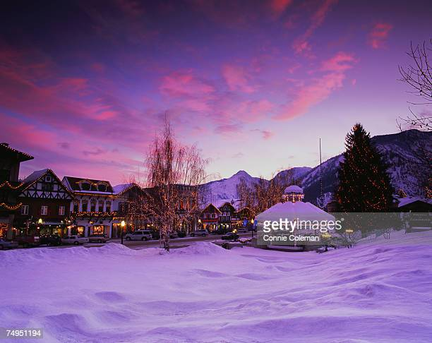 gazebo in snow covered park near street decorated with christmas lights - leavenworth washington stock photos and pictures