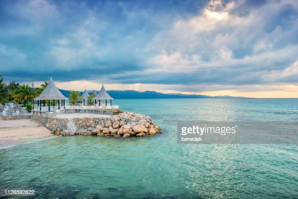 gazebos and beach in montego bay jamaica - jamaica stock pictures, royalty-free photos & images