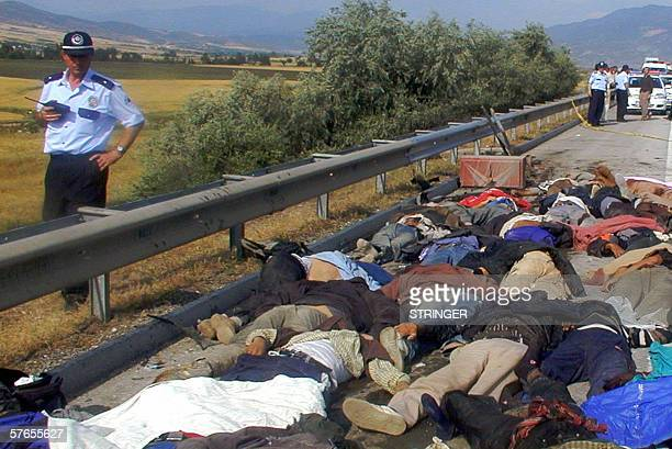A Policeman stand near the bodies at the accident site after a truck carrying illegal immigrants from Afghanistan and Bangladesh crashed into a...