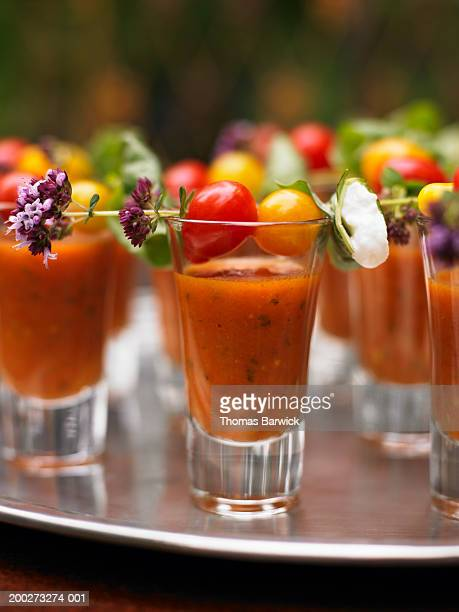 gazpacho shooter with cherry tomato garnish, close-up - bloody mary stock photos and pictures