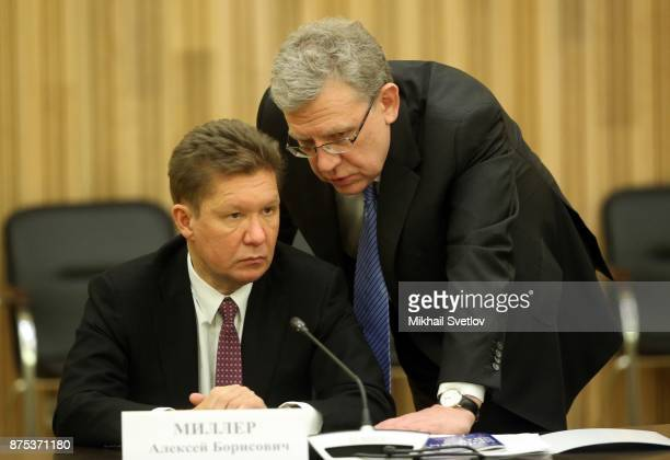 Gazprom's CEO Alexey Miller listens to economist Alexey Kudrin during a meeting with members of the border of trustees of the Mariinsky Theatre...