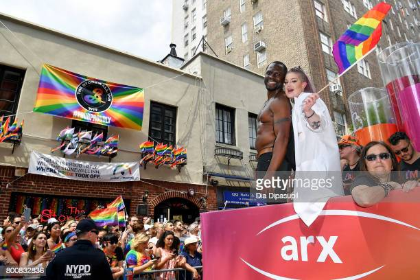 Gbenga Akinnagbe Kelly Osbourne ride the amfAR #BeEpicEndAIDS float during the 2017 New York City Pride March on June 25, 2017 in New York City.