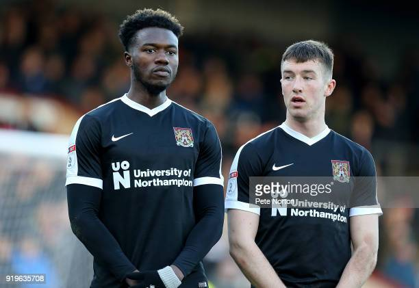 Gboly Ariyibi and Chris Long of Northampton Town line up to defend a free kick during the Sky Bet League One match between Scunthorpe United and...
