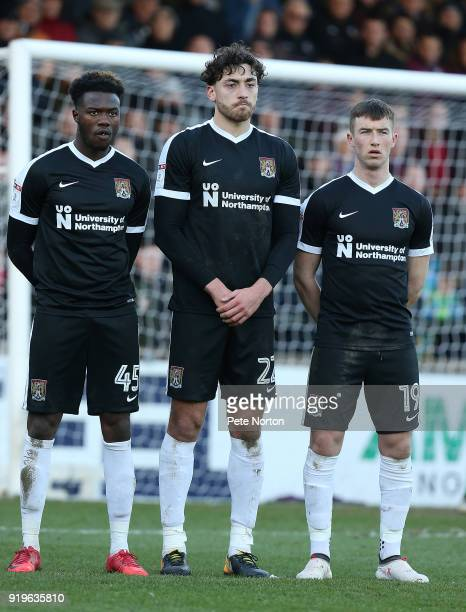 Gboly Ariyibi Matt Crooks and Chris Long of Northampton Town line up to defend a free kick during the Sky Bet League One match between Scunthorpe...