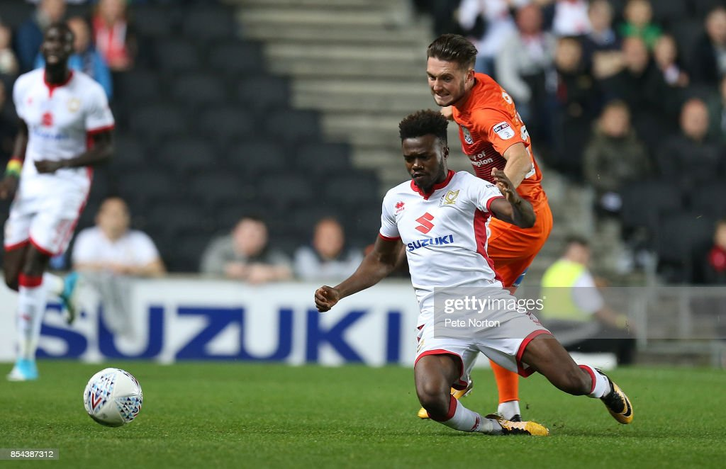 Gboly Ariyibi of Milton Keynes Dons attempts to move away from Matt Grimes of Northampton Town during the Sky Bet League One match between Milton Keynes Dons and Northampton Town at StadiumMK on September 26, 2017 in Milton Keynes, England.