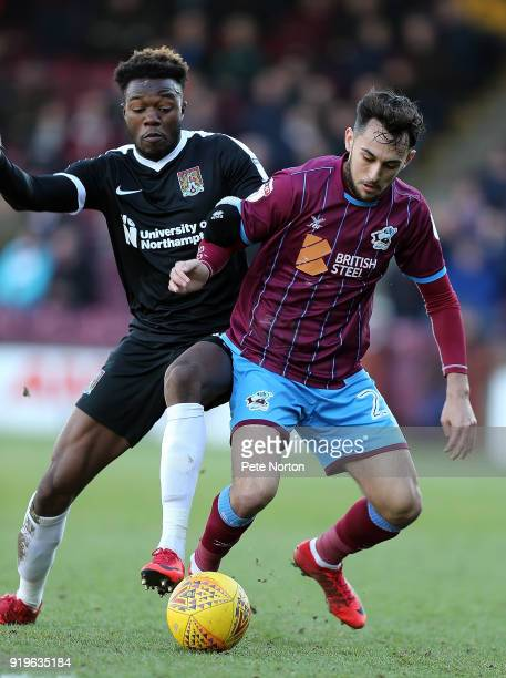 Gboly Ariyibi of Northampton Town and Levi Sutton of Scunthorpe United contest the ball during the Sky Bet League One match between Scunthorpe United...