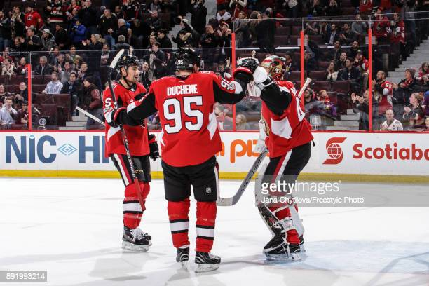 GCraig Anderson Matt Duchene and Cody Ceci of the Ottawa Senators celebrate their win against the New York Rangers at Canadian Tire Centre on...