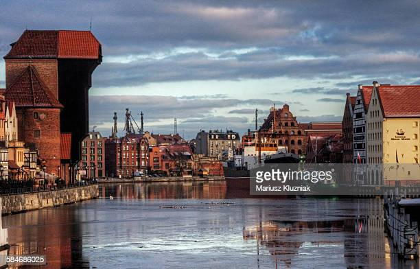 gdansk crane gate and docklands reflections - pomorskie province stock photos and pictures