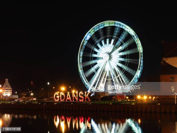 gdansk letters sign illuminated at night, poland - motlawa river stock pictures, royalty-free photos & images
