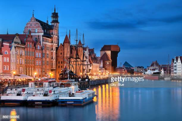 gdansk old town and motlawa river at night - pomorskie province stock photos and pictures