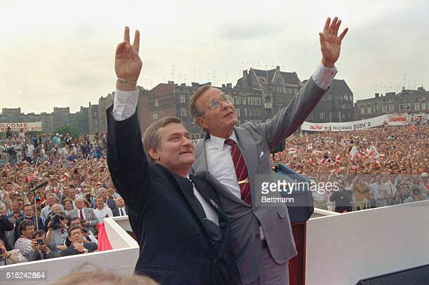 President George Bush and Solidarity leader Lech Walesa stand before a crowd of thousands of people today in front of the monument dedicated to the...