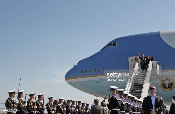 US President George W Bush and First Lady Laura Bush wave as they walk off Air Force One 08 June 2007 as they arrive at the Gdansk Lech Walesa...