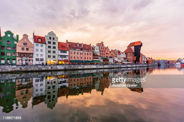 gdansk skyline at sunset seen at the waterfront of motlawa river, gdansk, poland - gdansk stock pictures, royalty-free photos & images