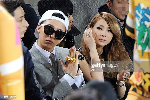 GDragon a member of the popular South Korean boyband Big Bang and CL a member of the Kpop girlband 2ne1 watch a fashion show held in Seoul on March...