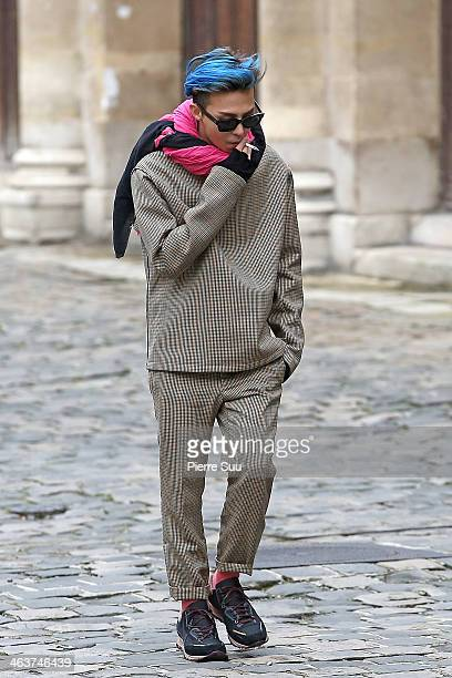 Dragon arrives at Lanvin Menswear Fall/Winter 20142015 show as part of Paris Fashion Week on January 19 2014 in Paris France