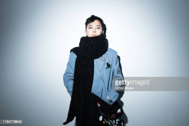 Dragon attends the WE11DONE Menswear Fall/Winter 20202021 show as part of Paris Fashion Week on January 19 2020 in Paris France