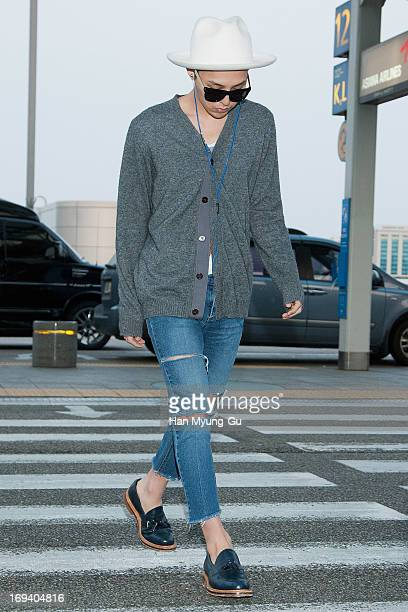 Dragon of South Korean boy band Bigbang is seen on departure at Incheon International Airport on May 24 2013 in Incheon South Korea
