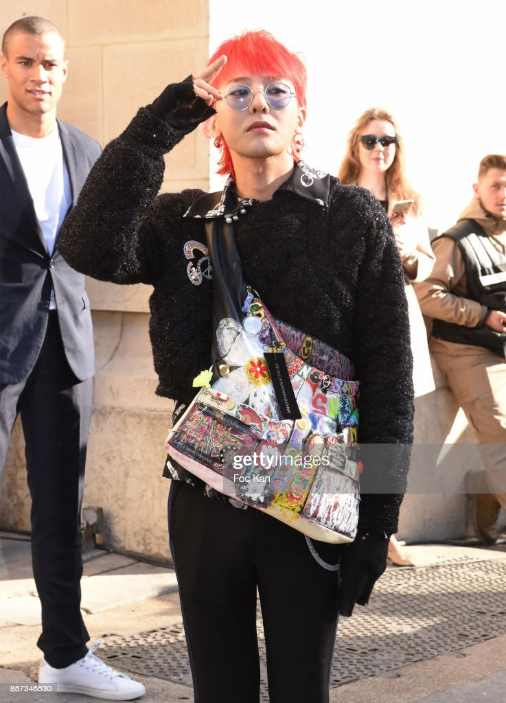 G-Dragon poses during the Chanel show as part of the Paris Fashion Week Womenswear Spring/Summer 2018 on October 3, 2017 in Paris, France.