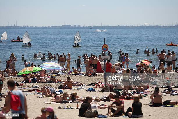 Gdynia, Poland 2nd, July 2015 Thousands of people enjoy sunbathing and swimming at the Baltic sea coast in Gdynia. Meteorologists predict over 36...