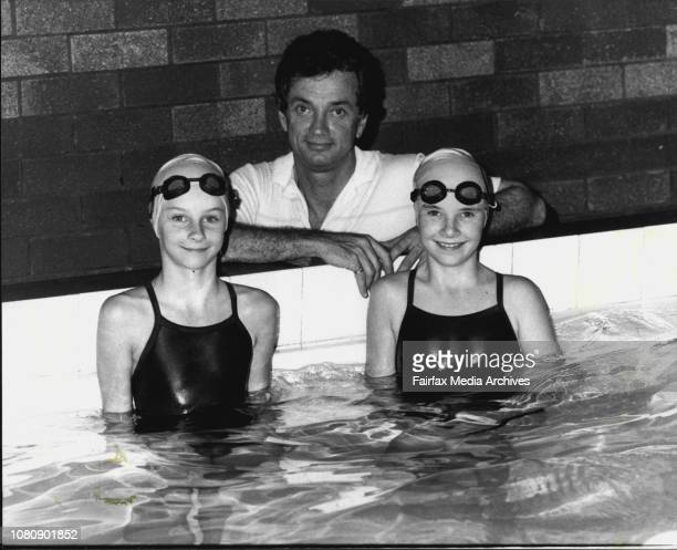 Geame Schroeder with his two daughters at the Forbes Carlile Pool Jackie and right Nikki April 17 1984