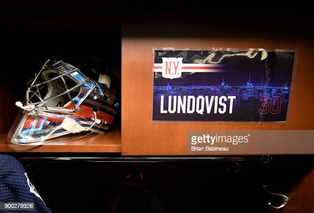 Gear belonging to Henrik Lundqvist of the New York Rangers sits in his locker room stall prior to the 2018 Bridgestone NHL Winter Classic between the...