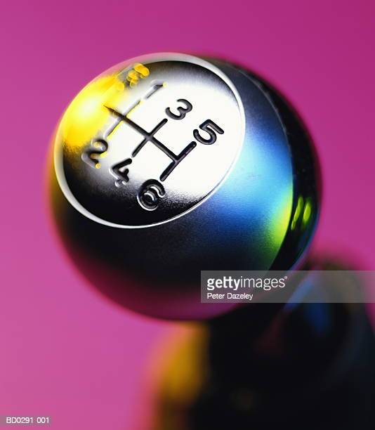 gear stick against pink background, close-up (brightly lit) - gearstick stock pictures, royalty-free photos & images