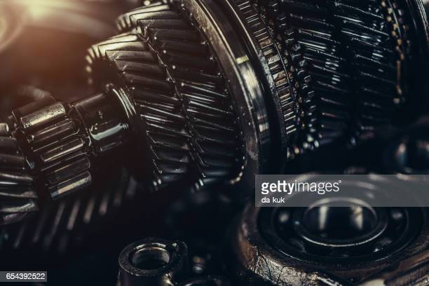 gearbox metal wheels close-up - motor oil stock pictures, royalty-free photos & images